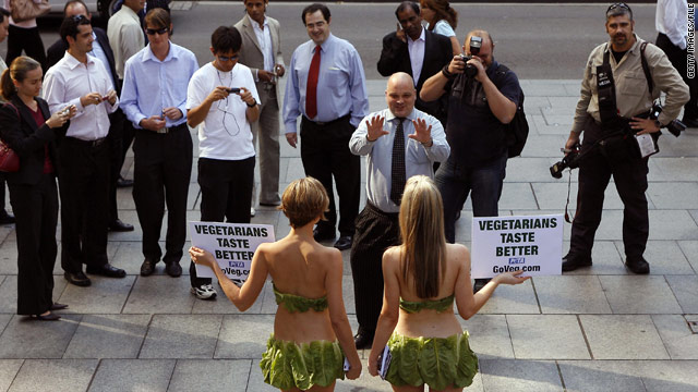 "Wearing lettuce bikinis, two ""Lettuce Ladies"" urge passersby to go vegetarian during a PETA protest in Sydney, Australia."