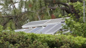 With the help of these solar panels, Patrick Vanderwyden says he reduced his energy use by 30 percent last year, compared to 2008.