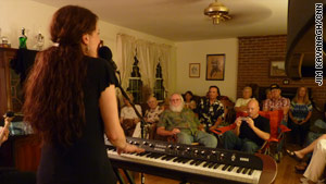 Kira Small performs R&B and soul in Bill and Teri Hooson's living room in Covington, Georgia.