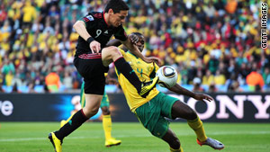 The World Cup got under way Friday, with South Africa and Mexico dueling to a tie.