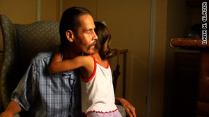 Ralph Benitez gets a hug from his grandaughter Kayla.