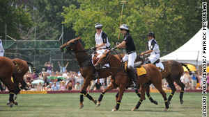 British Prince Harry is followed by  Argentine Nacho Figueras, captain of the Black Watch polo team.