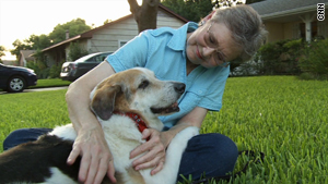 Hoffman helped give Lotto the dog a home with Joan McKinney.