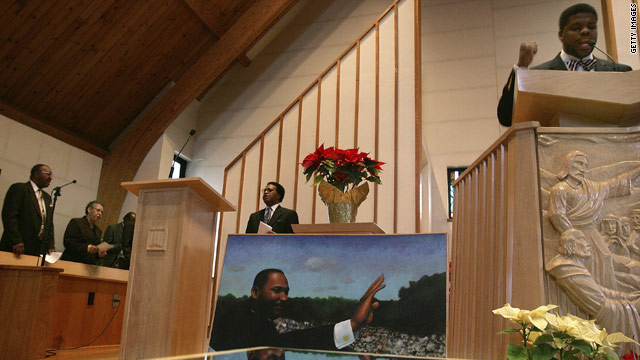 "The Rev. David O. Miller leads ""Lift Every Voice and Sing"" during a Martin Luther King Jr. memorial service in Bridgeport, Connecticut in 2007. The song is popular in churches, and also known as the black national anthem."