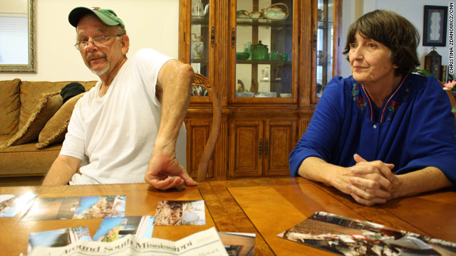 Paul and Carolyn Hollister, 72 and 67, look over photos of Hurricane Katrina&#039;s damage and reminisce about the devastating storm.