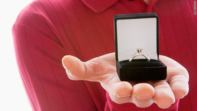 Her live-in boyfriend isn't committed to her until he gives her an engagement ring, a priest tells a young woman.