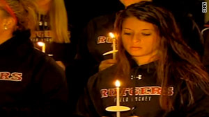 Students at Rutgers University mourn their classmate, Tyler Clementi on Sunday.