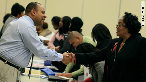Martin Wills of Chick-fil-A talks to a job seeker during a job fair at Maryland's Prince George's Community College.