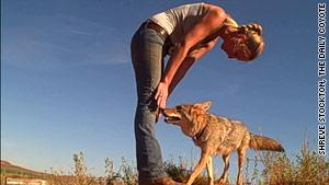 Shreve Stockton greets Charlie the coyote.