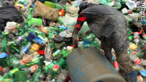 A man picks bottles for recycling at the Jardim Gramacho landfill site in Brazil.
