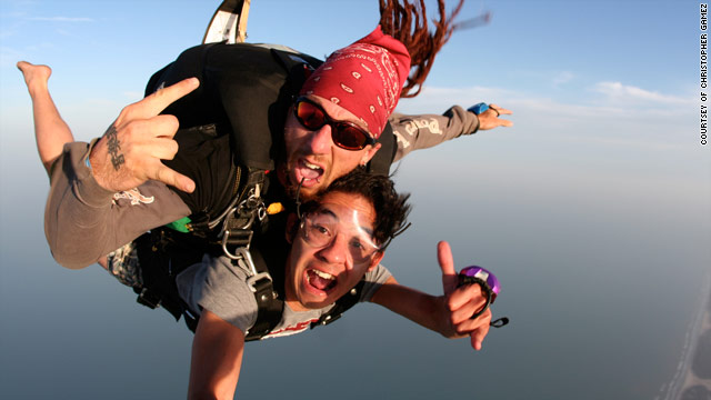 Christopher Gamez, 25, and a master skydiver floated  thousands of feet above South Padre Island's Coca Cola Beach.