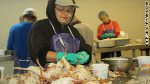 Workers in Bayou La Batre, Alabama, clean crab at one of the local shops where seafood is running low.