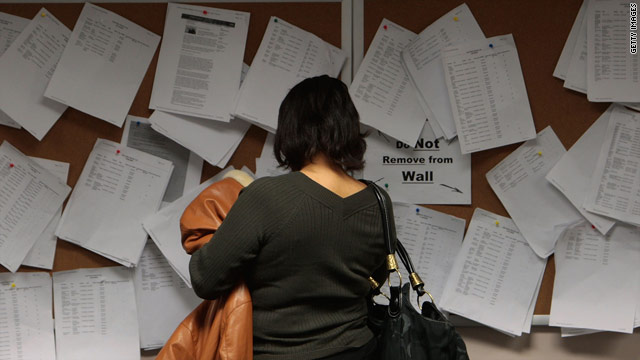 A woman looks over job postings in Brooklyn, New York. The current national unemployment rate is 9.7 percent.
