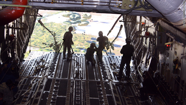 Bypassing the gridlocked airport and roads, the U.S. military delivered food and water to Haiti on Monday by parachute.