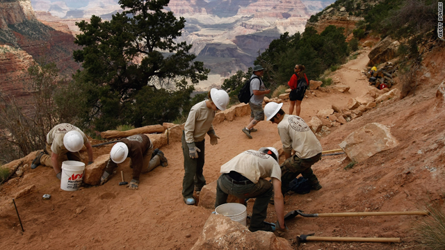 Conservation volunteers set rocks for a stimulus-funded trail rehabilitation project in Grand Canyon National Park in Arizona.