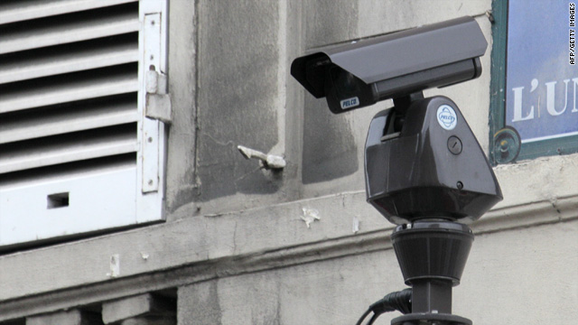 A video surveillance camera monitors the area near a ministry in Paris, France, this month.