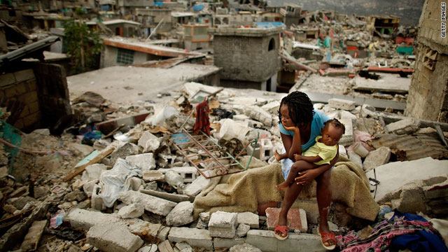 Sherider Anilus, 28, and her daughter, 9-month-old Monica, sit on the spot where her home collapsed during last month's earthquake in the Fort National neighborhood of Port-au-Prince, Haiti.