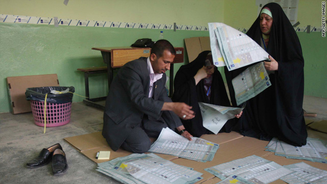 Iraqi election officials count votes Sunday at a polling station in the city of Karbala.
