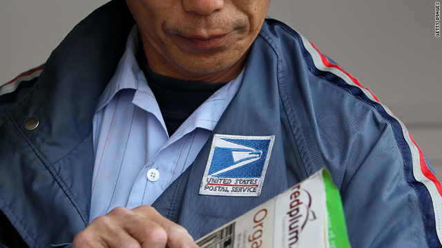 U.S. Postal Service letter carrier Raymond Hou sorts through mail along his route March 2 in San Francisco, California.