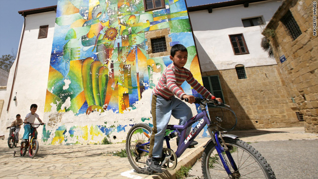 Children ride bicycles in Nicosia, Cyprus, in the Turkish-controlled northern part of the island.
