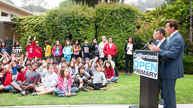 California Gov. Schwarzenegger answers questions from elementary school students at a news conference for Prop. 14.
