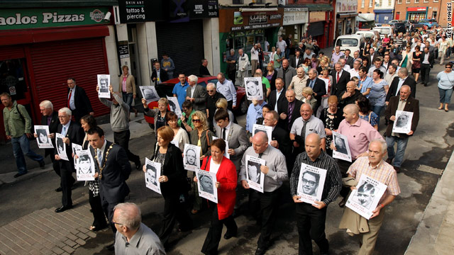 Families of victims of the Bloody Sunday shootings march through Londonderry on Tuesday holding photographs of relatives.