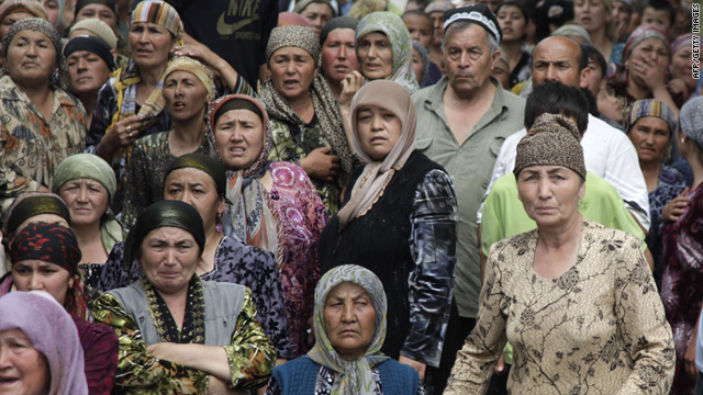 Refugees group near the border in hopes of crossing into Uzbekistan at a refugee camp near Osh, Kyrgyzstan, on June 15.