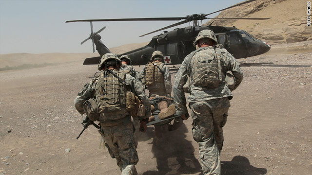 Paratroopers in the US Army's 82nd Airborne Division carry a seriously wounded Afghan civilian to Army Medevac helicopter.