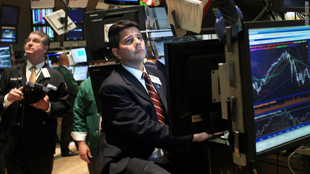 Traders work at the New York Stock Exchange this week when economic woes sent the Dow down nearly 270 points.