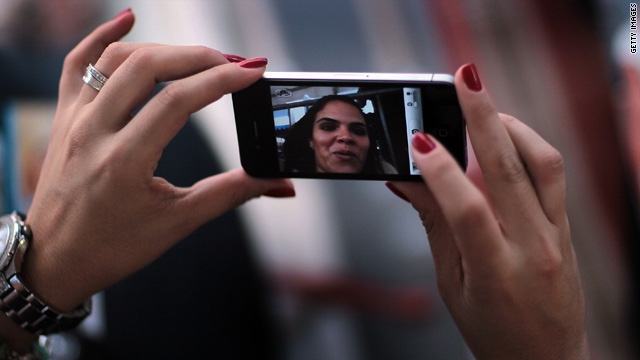 Jackie Quintero checks out a new Apple iPhone 4 as she waits in line to buy her own on June 23 in Miami Beach, Florida.