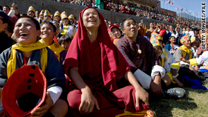 Bhutanese watching a game of pillow fighting during a coronation celebration on Nov. 8, 2008