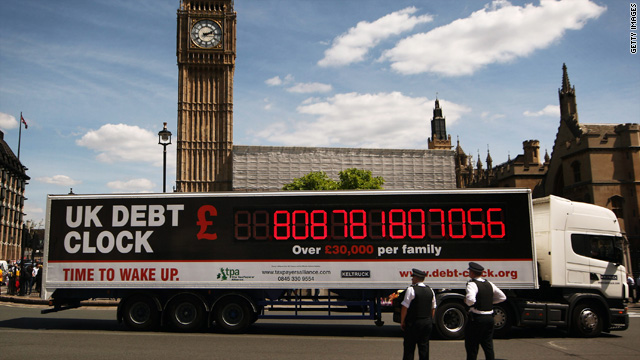 A truck displaying the United Kingdom's national debt drives around Parliament Square on June 22.
