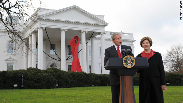 On World AIDS day in 2008, President George W. Bush makes a statement while First Lady Laura Bush looks on.