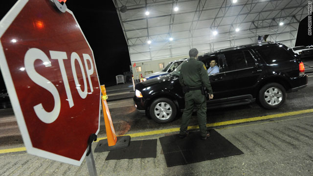 A U.S. Border Patrol agent checks vehicles arriving from Mexico near Nogales, Arizona, on July 28.