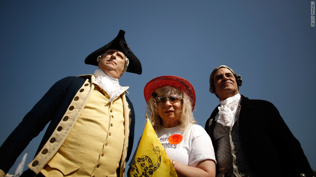 Historic re-enactors pose with Tea Party activist Nighta Davis of Georgia, during a pro-gun rally in Washington April 19.