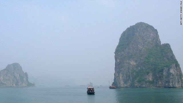Tourist junks cruise in Halong Bay in the Gulf of Tonkin on the northeastern coast of Vietnam.