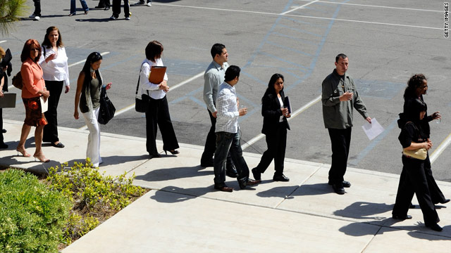 Prospective workers line up outside Rio Hotel & Casino during a job fair for Harrah's Entertainment, Inc. April 14 in Las Vegas.