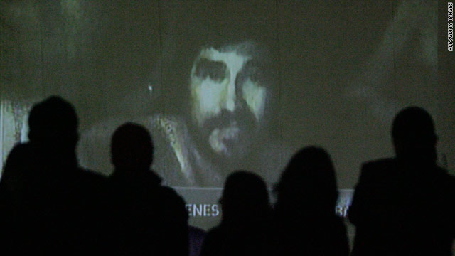 Relatives watch video of miners trapped in a gold and silver mine in Chile.