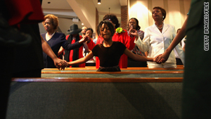 Congregants pray during a service at Shorter Community African Methodist Episcopal Church in Denver, Colorado.