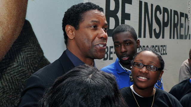 Denzel Washington shares a moment with some Boys and Girls Club members