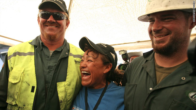 U.S. drill operator Jeff Hart, left, celebrates with Elizabeth Segovia, miner Dario Zegovia's sister, and co-worker Matt Staffel.