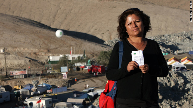 "Soledad Morales, wife of ""mine poet"" Victor Segovia, with a letter received from him September 16."