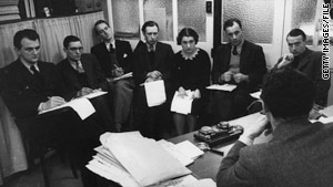 Journalists for a British magazine take part in an editorial conference in 1938.