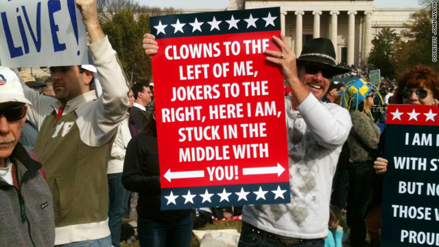 "The signs at the ""Rally to Restore Sanity"" used humor and emphasized a centrist message."