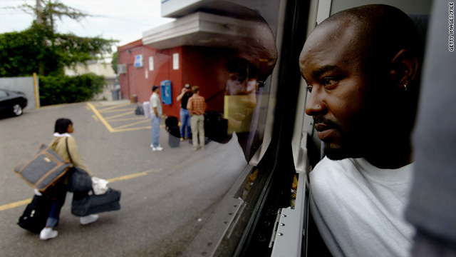 A passenger looks out the window of a Greyhound bus in South Dakota.