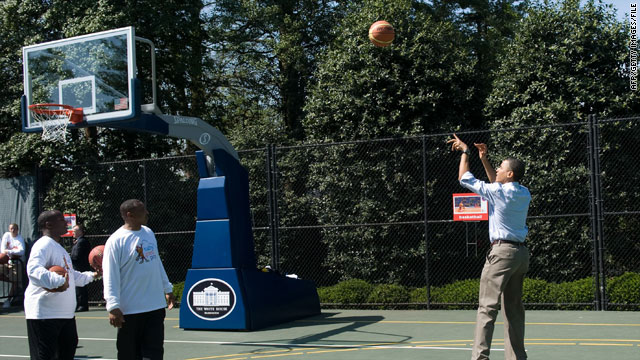 President Obama shoots a basketball during the annual White House Easter Egg Roll on April 5, 2010.