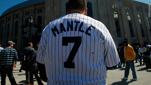 A fan wears a Mickey Mantle jersey outside the new Yankee Stadium before the first pitch on opening day April 16, 2009.