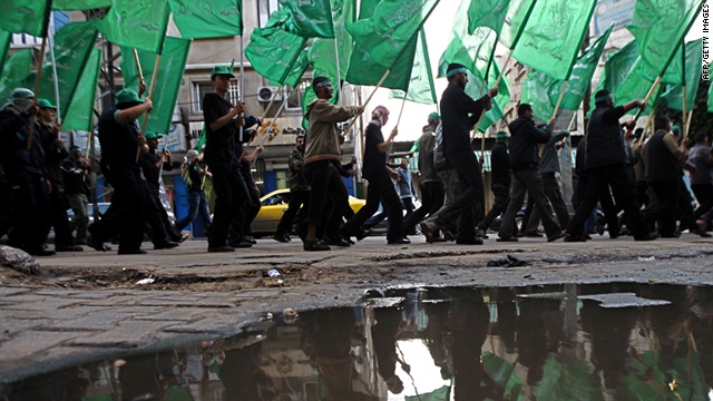 Hamas militants march in the southern Gaza Strip on December 6 to mark the movement's upcoming  23rd anniversary.