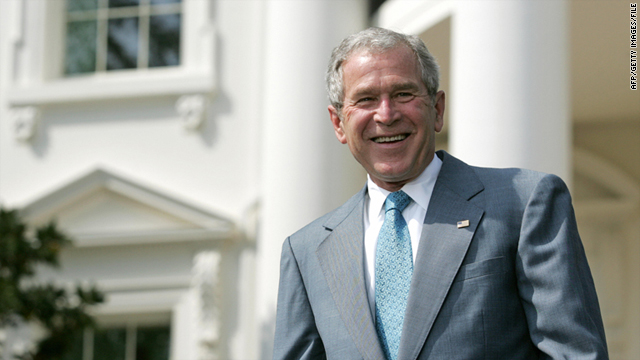 Then-President George W. Bush laughs during an event on the South Lawn of the White House on April 24, 2008.