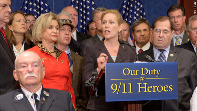 Sen. Kirsten Gillibrand argues for passage of the 9/11 responders bill, accompanied by first responder Capt. John Gallagher, left.